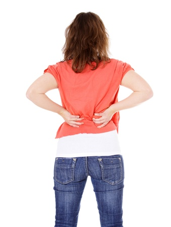 Attractive young woman suffering from back pain . All on white background.  photo