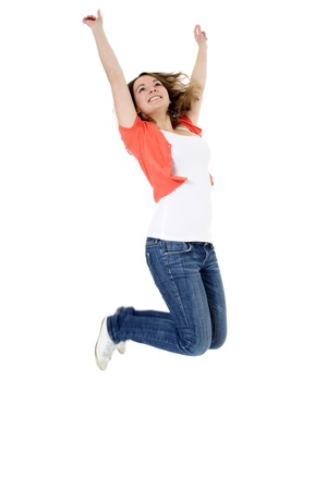 cheer full: Young woman jumping in the air. All on white background. Stock Photo