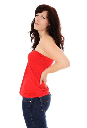 Attractive young woman suffers from back pain. All on white background.  photo