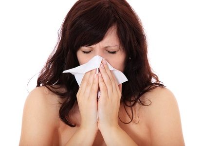 hayfever: Attractive young woman suffers from hayfever. All on white background.