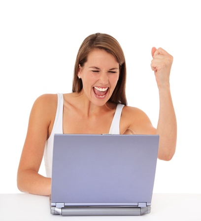 Attractive young woman cheering while using laptop. All on white background.