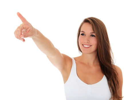 Attractive young woman pointing to the side. All on white background.