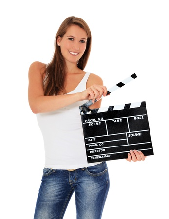 clapperboard: Attractive young woman using clapperboard. All on white background.  Stock Photo