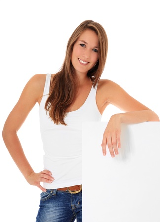 Attractive young woman standing next to blank sign. All on white background. Stock Photo - 10118502