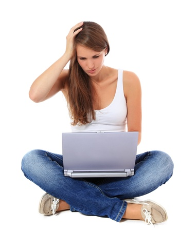 computer virus: Frustrated young woman using her notebook. All on white background.  Stock Photo