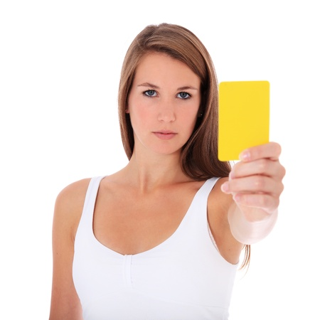 Attractive young woman showing yellow card. All on white background.  photo