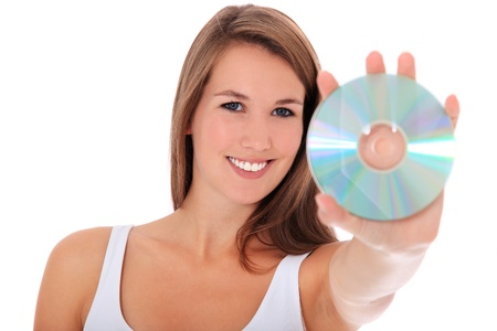 Attractive young woman holding dvd. All on white background.  photo