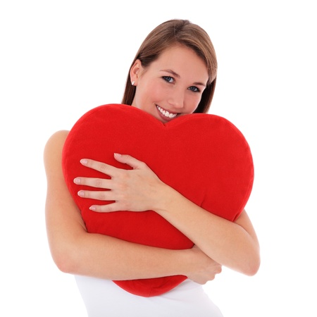 Attractive young woman red heart-shaped pillow. All on white background.  photo