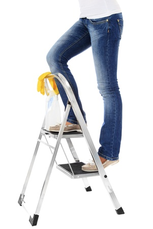 household accident: Woman standing on stepladder during housecleaning. All on white background.