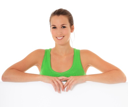 express positivity: Attractive young woman standing behind white sign. All on white background.