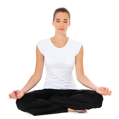 Attractive young woman in sports wear doing yoga. All on white background.  photo