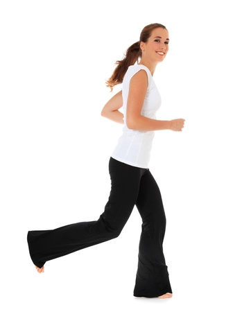 barefoot teens: Attractive young woman running in sports wear. All on white background.