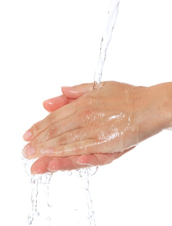 Female person washes her hands. All on white background.  免版税图像