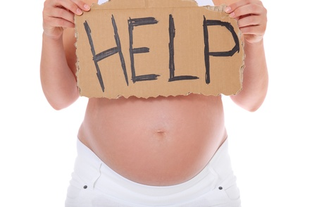 Pregnant woman holding cardboard showing the term help. All on white background.