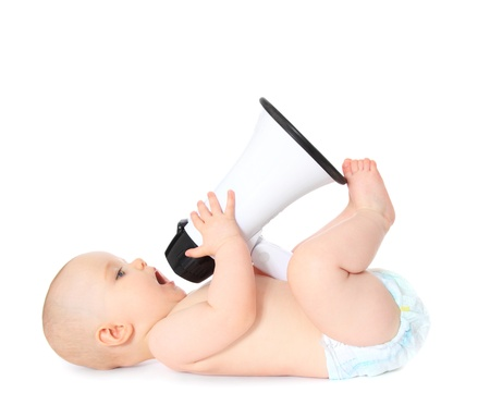 Newborn child playing with megaphone. All isolated on white background.