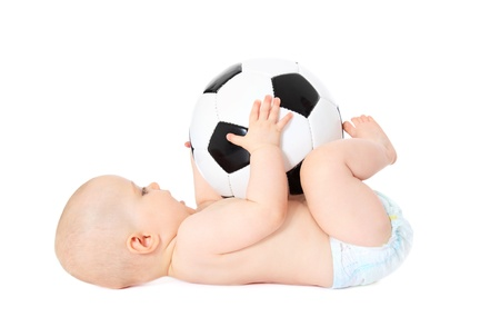 the descendant: Newborn child playing with a toy soccer ball. All isolated on white background.