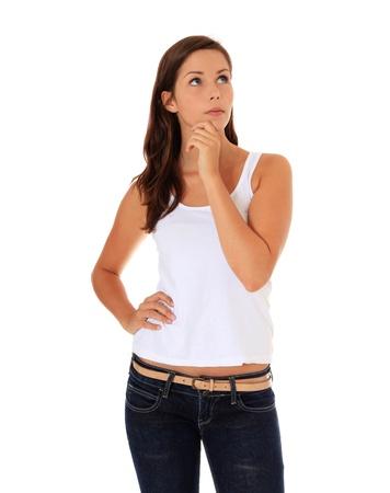 mujeres pensando: Mujer joven y atractiva delibera una decisi�n. Todos en el fondo blanco.