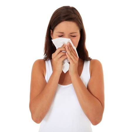 Attractive young woman suffers from hayfever. All on white background.  photo