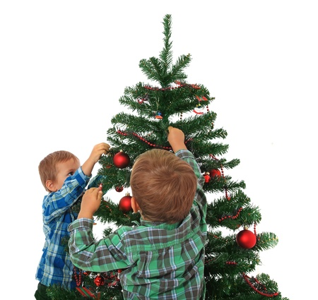 decorating christmas tree: Two cute caucasian boys decorating the christmas tree. All on white background.