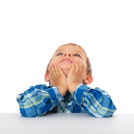 Cute caucasian boy looking up. All on white background.