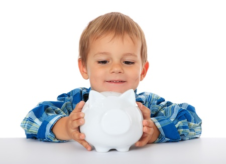 subsidy: Cute caucasian boy holding piggy bank. All on white background.