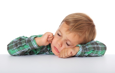 Tired caucasian boy. All on white background.