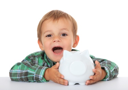 infancy: Cute caucasian boy with his piggy bank. All on white background.  Stock Photo