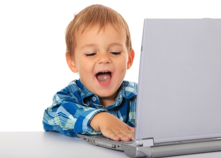 informatics: Cute caucasian boy using laptop. All on white background.  Stock Photo