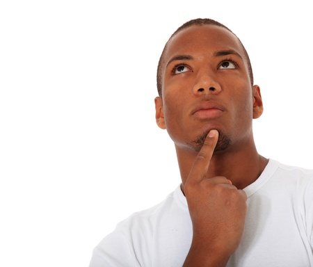 Attractive black man deliberates a decision. All on white background. Extra text space on the left.