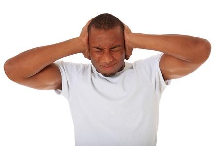 splitting headache: Attractive black man keeps his ears shut. All on white background.  Stock Photo