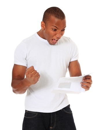 jubilating: Attractive black man getting good news. All on white background.  Stock Photo