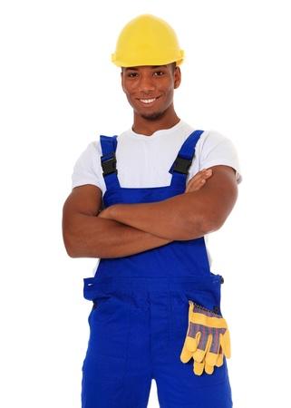 overol: Trabajador manual negro atractivo. Todo sobre fondo blanco.  Foto de archivo