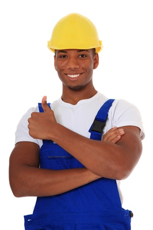 dark skinned: Attractive black manual worker showing thumbs up. All on white background.