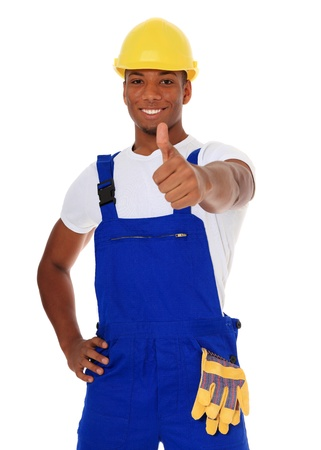 qualified worker: Attractive black manual worker showing thumbs up. All on white background.