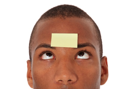 Attractive black with blank post-it note on his forehead. All on white background.  photo