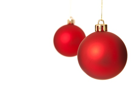 christmasy: Two red christmas tree ball ornaments. Isolated on white background.