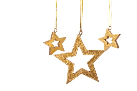 christmasy: Three decorative golden stars. Isolated on white background. Stock Photo