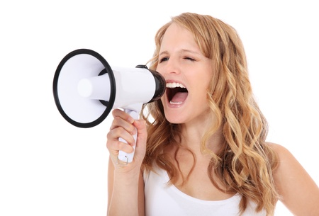 loudhailer: Attractive young woman shouting through megaphone. All on white background.  Stock Photo