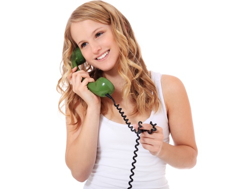 Attractive young woman making a phone call. All on white background. Stock Photo - 11246832