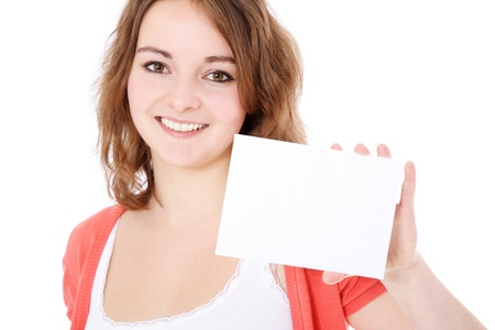 Attractive young woman holding a business card. All on white background.  photo