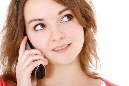 Attractive young woman making a phone call. All on white background.  photo