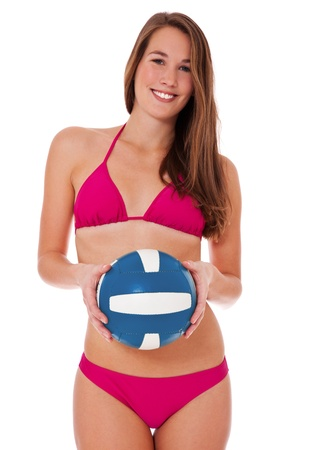 Attractive woman in bikini holding a volleyball. Isolated on white background. photo
