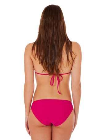 Backside of an attractive woman in bikini. Isolated on white background. photo