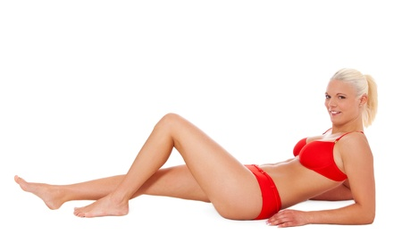 the whole body: Attractive women in bikini lying on the floor. Isolated on white background.