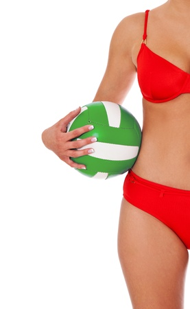 bathing costume: Attractive woman in bikini holding a volleyball. Isolated on white background.