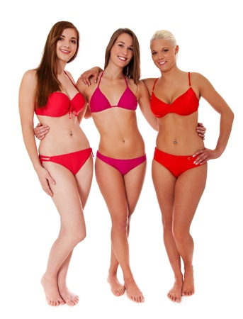 Frontside of three attractive women in bikini. Isolated on white background. photo