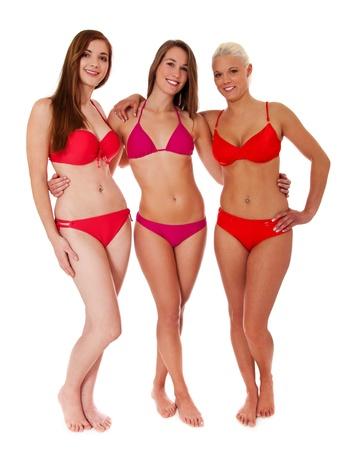 Frontside von drei attraktiven Frauen im Bikini. Isoliert auf weißem Hintergrund. Standard-Bild - 11544813