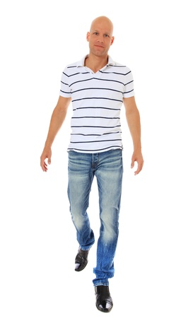 easy going: Full length shot of an attractive man walking. All on white background.
