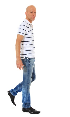 Full length shot of an attractive man walking. All on white background.
