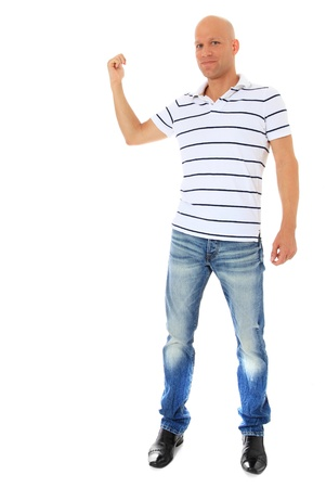 Full length shot of an attractive man pointing at the background. All isolated on white.  photo